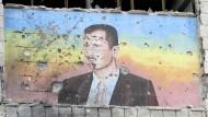 Der Konterfei von Präsident Assad ziert eine Fassade in der syrischen Stadt Aleppo