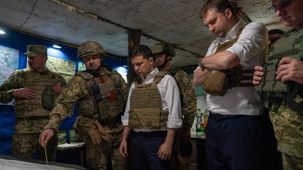 Weiterer Truppenabzug im Donbass hat begonnen