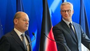 Frankreich droht Amerika, Scholz mahnt zur Besonnenheit