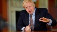 Boris Johnson erläutert bei seiner Fernsehansprache am Sonntagabend ein neues Covid-Alarmsystem, das als Richtlinie der Lockerungen dienen soll.