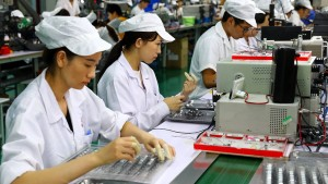 Chinas Wirtschaft wächst ein wenig langsamer