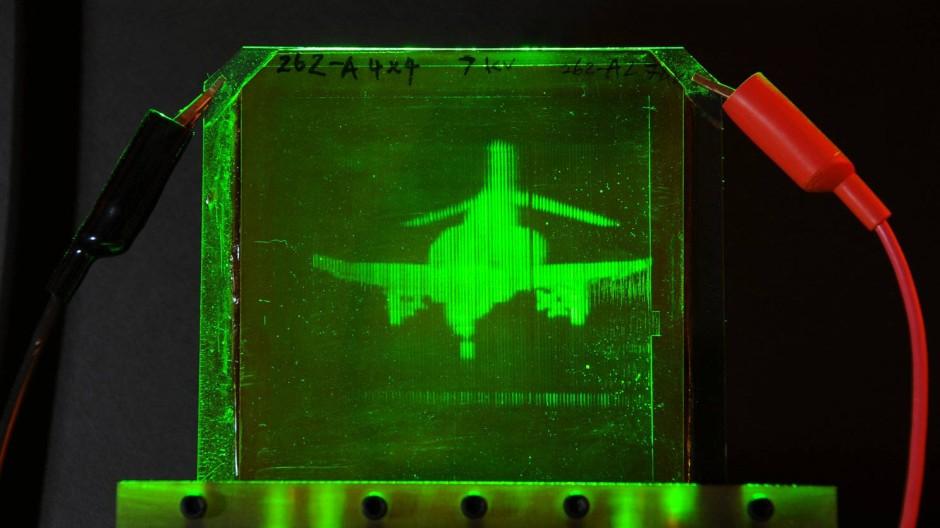 Echtzeit, grenzenlos und dreidimensional: An der Universität von Arizona haben Wissenschaftler dafür eine Holographie-Technik entwickelt