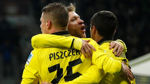 Borussia Dortmund's players celebrate a goal against Bayer Leverkusen during the German first division Bundesliga soccer match in Leverkusen