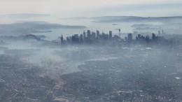 Sydney in dichte Rauchwolken gehüllt