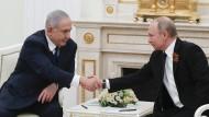 Der israelische Ministerpräsident Benjamin Netanjahu (links) und Russlands Präsident Wladimir Putin bei einem Treffen im Kreml.