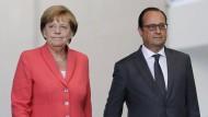 Merkel und Hollande für verbindliche Flüchtlingsquoten