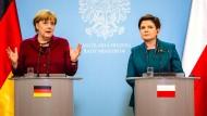 Merkel mit Trumps Klarstellungen zufrieden