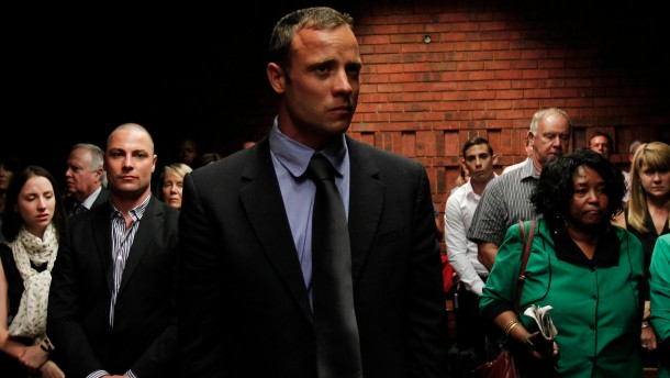 """Blade Runner"" Oscar Pistorius awaits the start of court proceedings in the Pretoria Magistrates court"