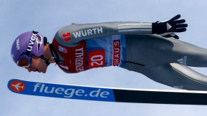 Germany's Schmitt soars through the air during the trial jump for the second jumping of the 61st four-hills ski jumping tournament in Garmisch-Partenkirchen