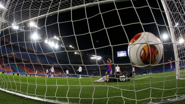 FC Basel's Delgado celebrates after scoring a goal against Valencia's goalkeeper Guaita during their Europa League quarter-final first leg soccer match in St.Jakob-Park stadium in Basel