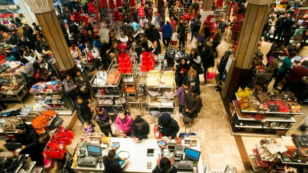 Shoppers look over items on sale at a Macy's store in New York