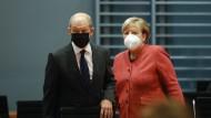 Kleckern, nicht klotzen: Bundesfinanzminister Olaf Scholz (SPD) und Kanzlerin Angela Merkel (CDU)