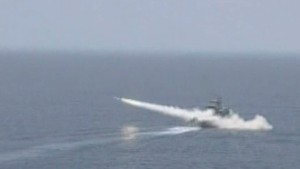 Still image of footage of Iranian warship launching a missile in an unknown location