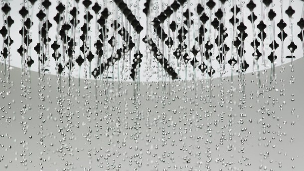 Water drops falling from shower head