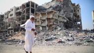 Palästinenser kehren in zerstörte Häuser zurück