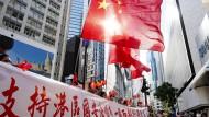 So wünscht sich China das neue Hongkong: Menschen feiern die Verabschiedung des nationalen Sicherheitsgesetzes im Viertel Causeway Bay.
