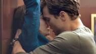 Jamie Dornan und Dakota Johnson in Fifty Shades of Grey
