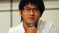 Der chinesische Blogger, Romancier und auch Rennfahrer Han Han. Hier auf einer Pressekonferenz im letzten Sommer in Hong Kong.