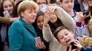 Ein Selfie mit der Kanzlerin: Die Aura der Bürgernähe