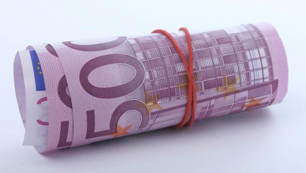 500 Euro Geldschein - Fotoillustration Geldabheben in der Finanzkrise