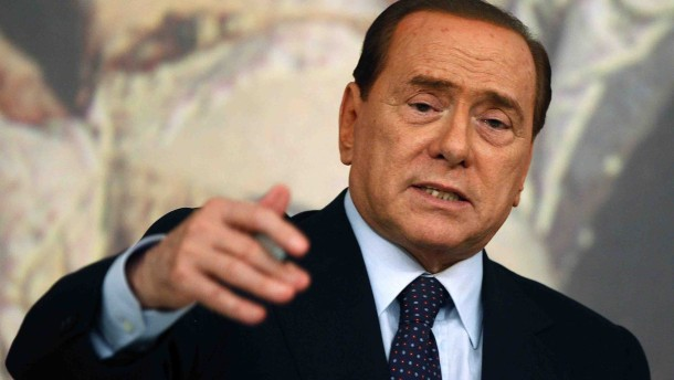 Italian Prime Minister Silvio Berlusconi gestures as he talks talks during a news conference in Rome