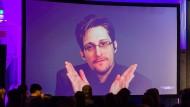 Aus dem Exil von Putins Gnaden: Edward Snowden nimmt über eine Liveschaltung an einer Berliner Konferenz teil.