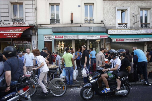 Muslims queue to buy traditional sweets for their first Iftar meal, or breaking fast, during the Muslim month of Ramadan in Paris