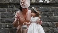 Und sie entwickeln sich doch: die britische Prinzessin Charlotte mit Mutter Catherine bei der Hochzeit ihrer Tante Pippa