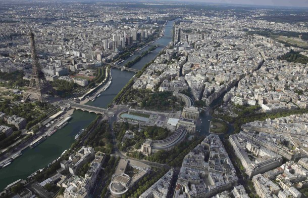 An aerial view shows the Eiffel tower, the Seine River and the Paris skyline