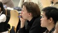 Es droht das Bad Simple English: Studenten im Hörsaal an der TU München
