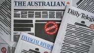 Protest: Australiens Zeitungen erschienen am Montag mit weniger Text als sonst.