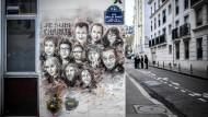 """Am einstigen Redaktionssitz von """"Charlie Hebdo"""" in der Rue Nicolas Appert in Paris hat der Straßenmaler Christian Guemy die Opfer verewigt."""