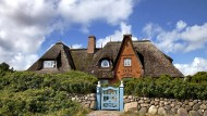 Haus mit Strohhut