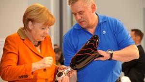 Merkel geht unter die Handwerker