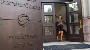 A woman leaves Budapest Stock Exchage building in Budapest