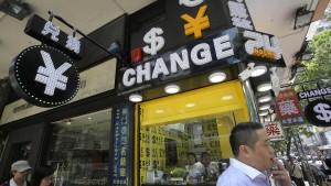 Chinas Notenbank wertet Yuan wieder ab