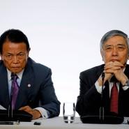 Japans Finanzminister und Notenbankpräsident treten gemeinsam auf.