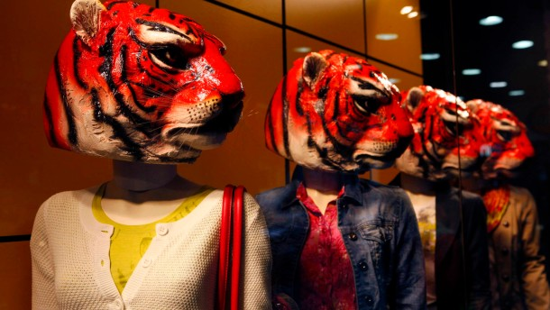 Mannequins decorated with tiger heads are displayed in front of a clothing boutique ahead of Chinese Lunar New Year celebrations in Taipei, Taiwan