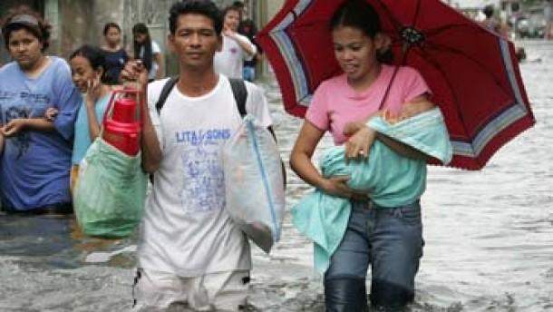 Mehrere Tote bei Unwettern in Asien