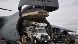 Utility vehicles and crews from California are off-loaded at Stewart Air National Guard Base in Newburgh in this handout photo