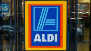 A customer leaves an Aldi supermarket, which has ordered a recall of two frozen prepared meals that had contained horse meat in tests, in northwest London