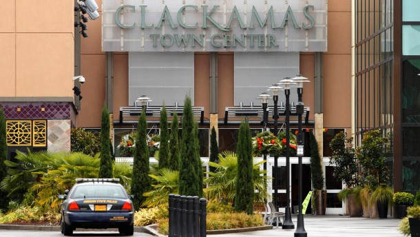 A police car is stationed in front of Clackamas Town Center shopping mall in Portland, Oregon