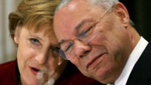 German Chancellor Merkel smiles next to former secretary of state Powell during a reception in Washington