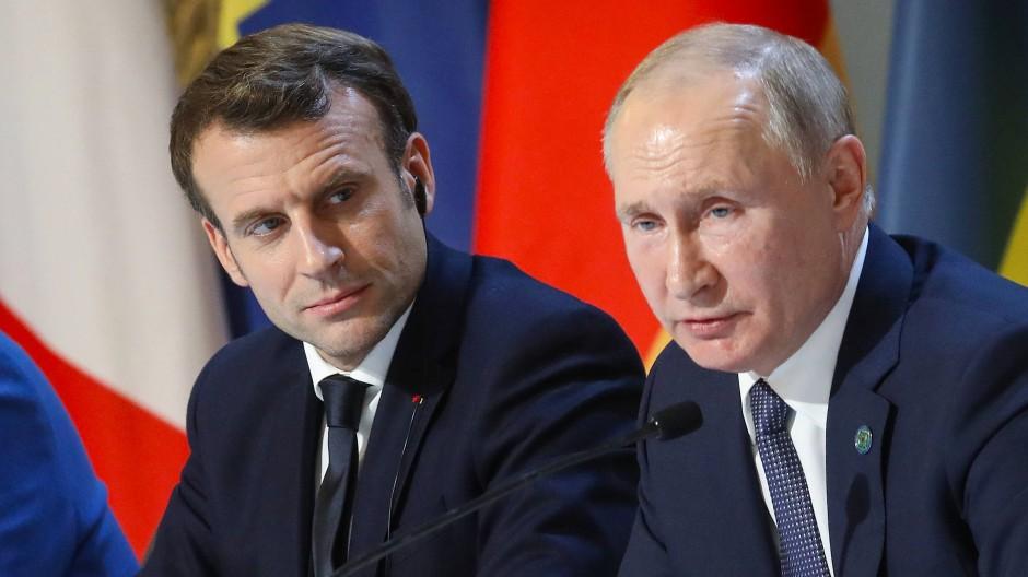 Präsidenten Macron und Putin in Paris