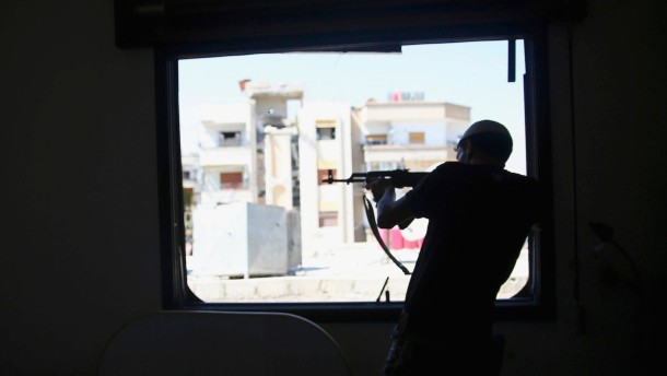 A member of 'Ahrar Dimachk' Brigade, part of 'Asood Allah' Brigade which operates under Free Syrian Army takes aim on one of battlefronts in Jobar