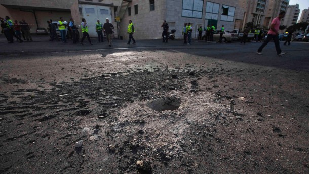 Hole in the road is seen after a rocket fired from Gaza landed in Ashdod