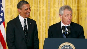 U.S. President Obama smiles at Defense Secretary-nominee Hagel at the White House in Washington