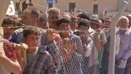 Geflohene Kurden kehren zum Kämpfen nach Syrien zurück