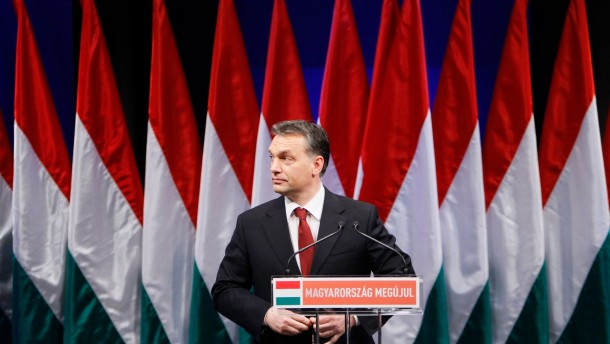 Hungarian Prime Minister Orban reacts when presenting his annual state-of-the-nation speech in Budapest