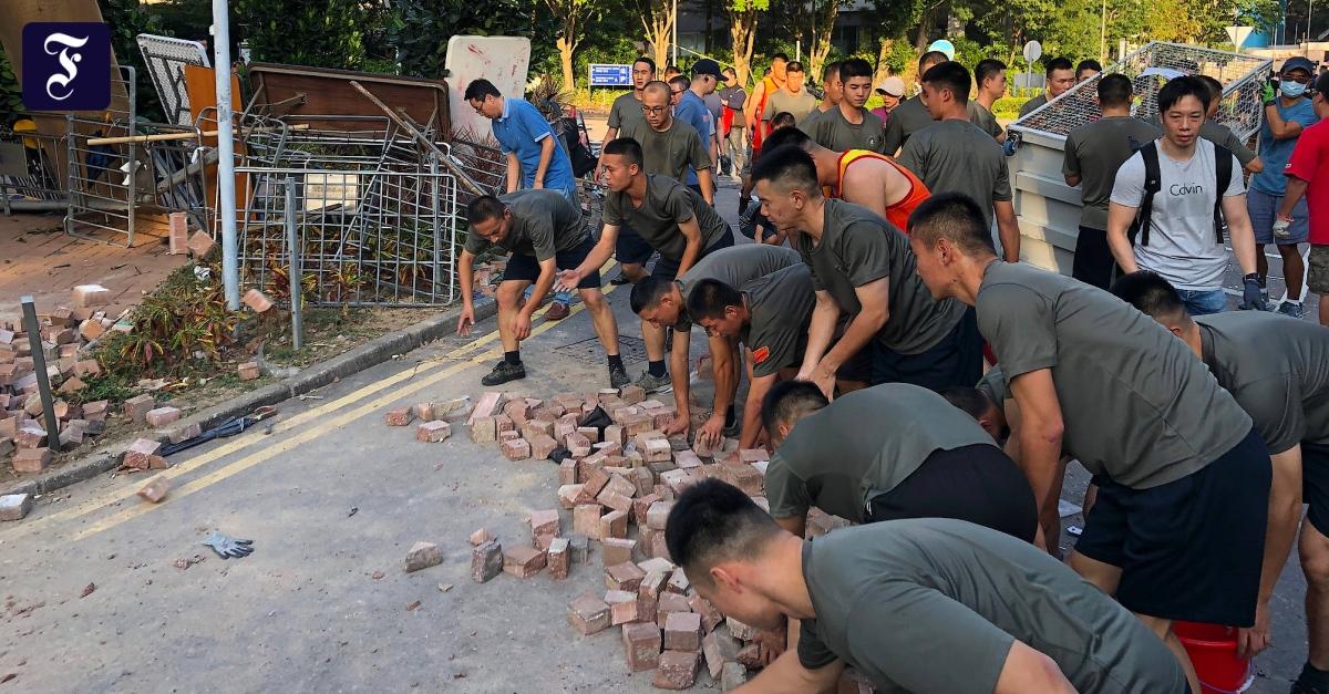 Wenn Chinas Armee zum Putzen ausrückt - FAZ - Frankfurter Allgemeine Zeitung image